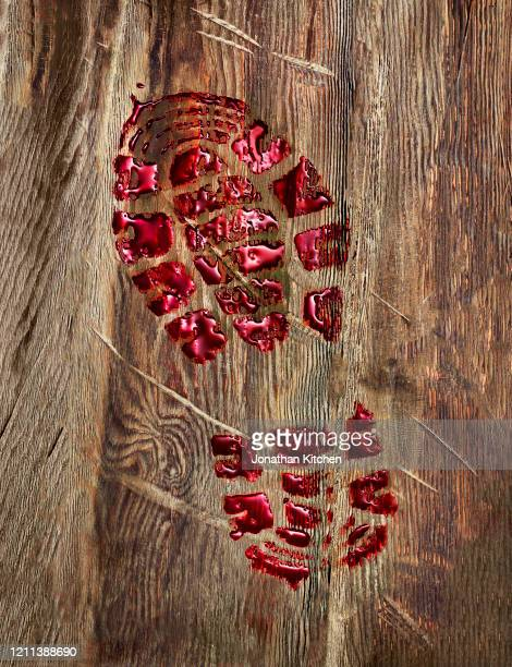 blood soaked boot print - crime scene stock pictures, royalty-free photos & images