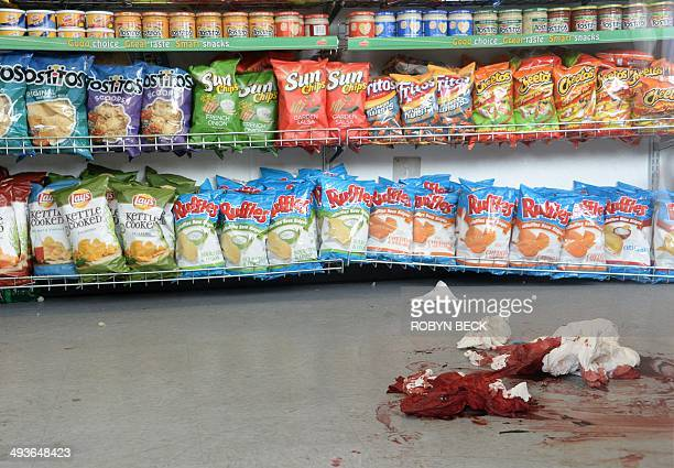 Blood soaked towels are seen on the floor of IV Deli Mart, one of the locations of a drive-by shooting last night, in Isla Vista, California, a beach...