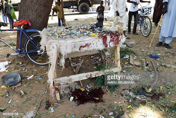 Blood stains and abandoned footwear litter the scene of a suicide blast in the northeastern Nigerian city of Potiskum on February 1 2015 A suicide...