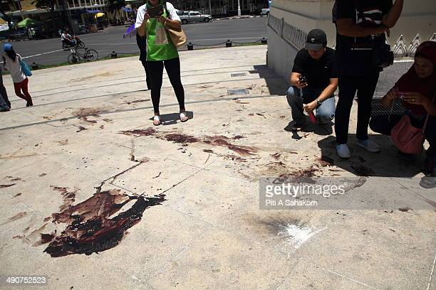 Blood stains of Thai antigovernment protesters near the site of a driveby shooting and grenade attack on an antigovernment protesters at the...