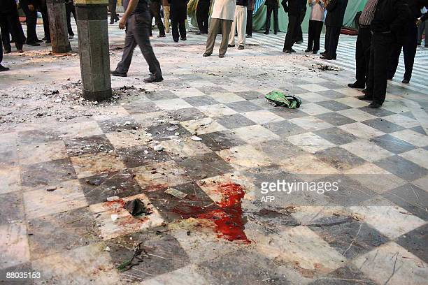 Blood stains the ground inside the Amir alMomenin mosque following a bomb blast in the southeastern Iranian city of Zahedan on May 28 2009 A bomb...