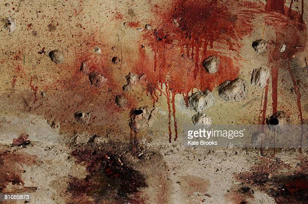 Blood stains the wall of a garage marking the site of reported killings of three Druze during sectarian clashes May 12 2008 in Shweifat near Beirut...