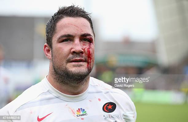 Blood streams down the face of Brad Barritt the Saracens centre during the Aviva Premiership play off semi final match between Northampton Saints and...