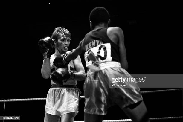 Blood streams down the face of Davy Lamour but he outpointed Maina of Kenya in their quarterfinals flyweight boxing bout in the Commonwealth Games at...