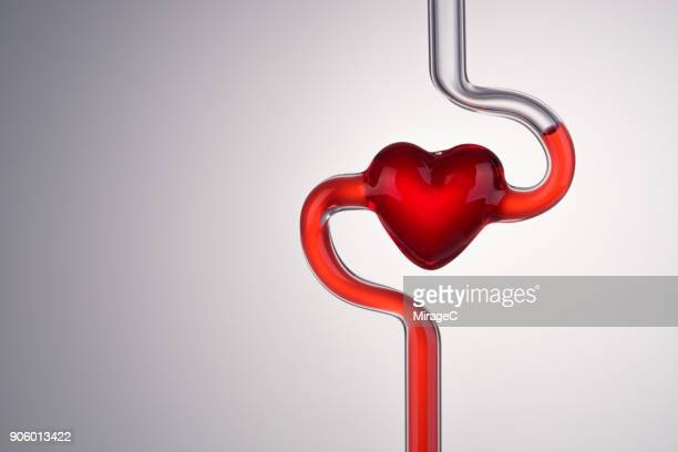blood vessel and heart abstract - red tube stock pictures, royalty-free photos & images