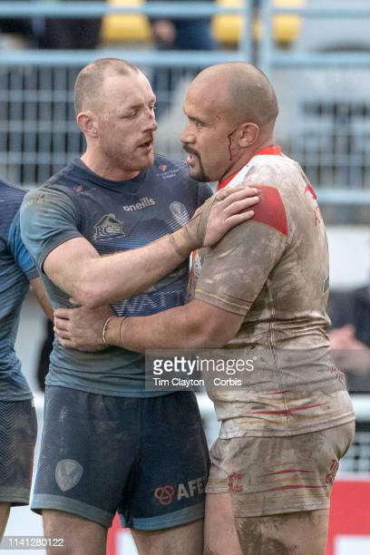 April 6: Blooded and battle scared James Roby of St. Helens and Sam Moa of Catalans Dragons embrace at the end of the game during the Catalans...