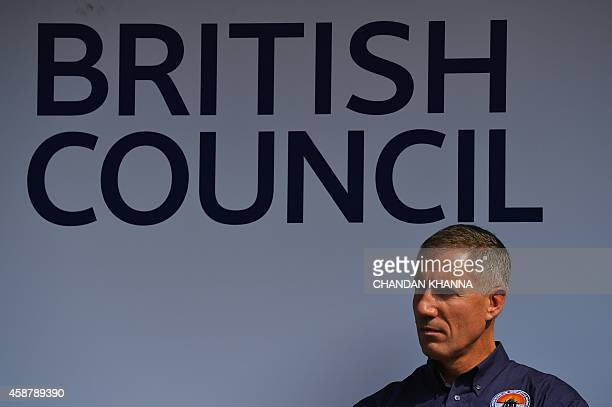 Bloodhound SuperSonic Car driver Wing Commander Andy Green poses during the Bloodhound Show Car display in New Delhi on November 11 2014 Currently in...