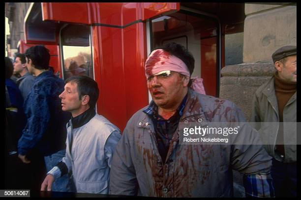 Bloodied headbandaged man amid protestors during violent clash w special Int Ministry riot police in procommunist antiYeltsin May Day demo
