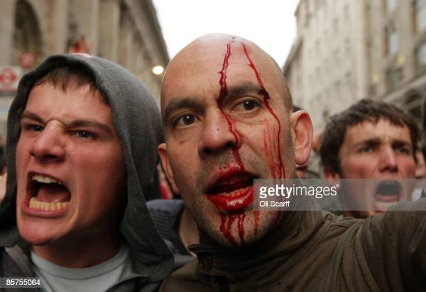 Bloodied protesters shout at police near to the Bank of England as anti capitalist and climate change activists demonstrate in the City of London on...