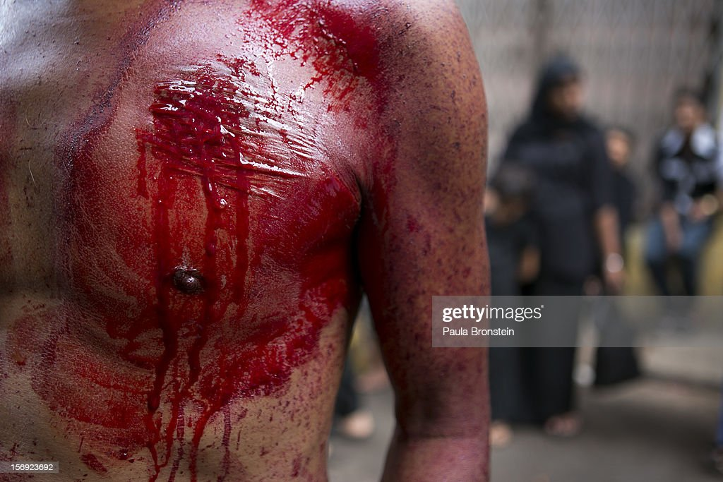Bloodied scars mark the chest of a man as Shia muslims mark the Day of Ashura, striking themselves till they are bloody with razors and chains November 25, 2012 in Yangon, Myanmar. The day of Ashura is a national holiday held on the 10th day of Muharram in the Islamic calendar, with men beating themselves as they mourn the martyrdom of Husayn ibn Ali, the grandson of the Islamic Prophet Muhammad. There are approximately 20,000 Shia muslims in Myanmar.