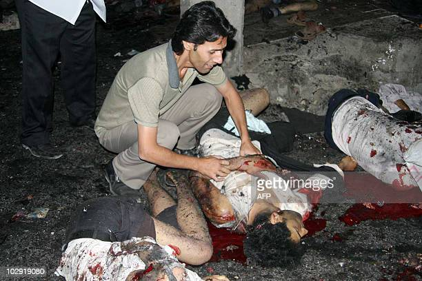 Bloodied victims lie outside the Jameh mosque in the southeastern Iranian city of Zahedan on July 15 2010 Two suicide bombings at a Shiite mosque in...