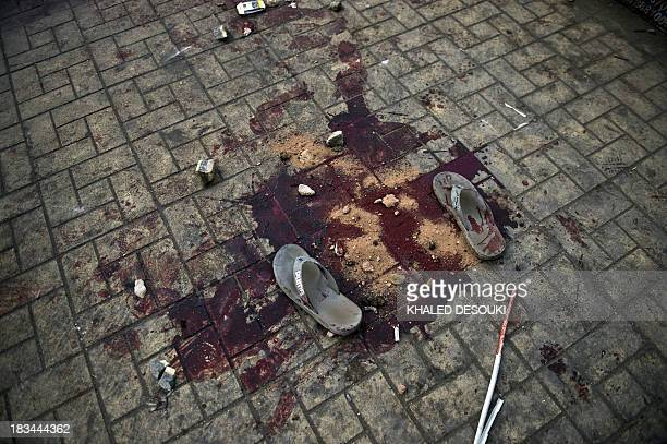 Bloodstains are seen on the ground in Ramsis street in downtown Cairo following clashes between Egyptian riot police and Muslim Brotherhood...