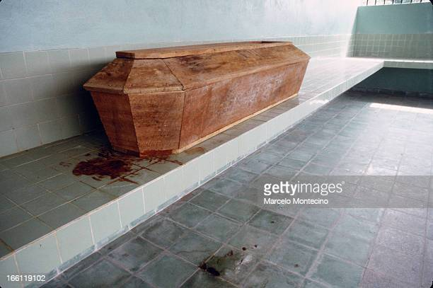 Bloody coffin awaits burial at the morgue in El Salvador, 1982