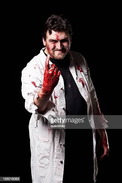 bloody doctor halloween costume portrait on black, copy space - evil stock photos and pictures