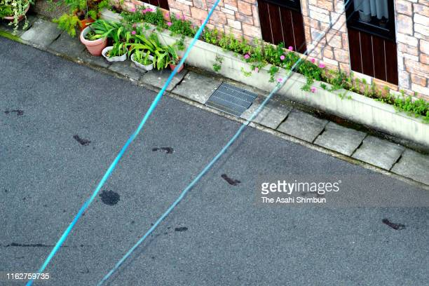 Bloody footprints believed to be those of an arson suspect, who ran away with bare feet, are seen on the road after a fire at a studio of Kyoto...