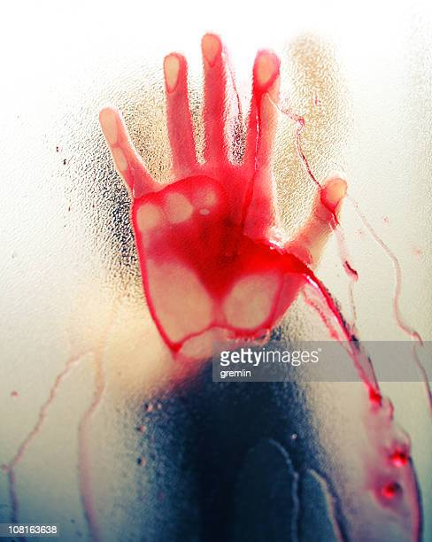 bloody hand against frosted window - bloody hand stock photos and pictures