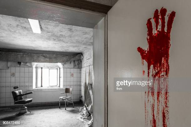 Bloody handprint on the door of a medical room