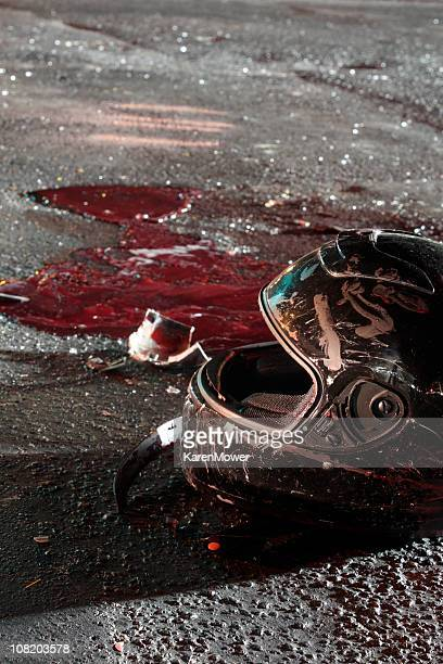 bloody helmet on pavement after crash - bloody car accidents stock pictures, royalty-free photos & images