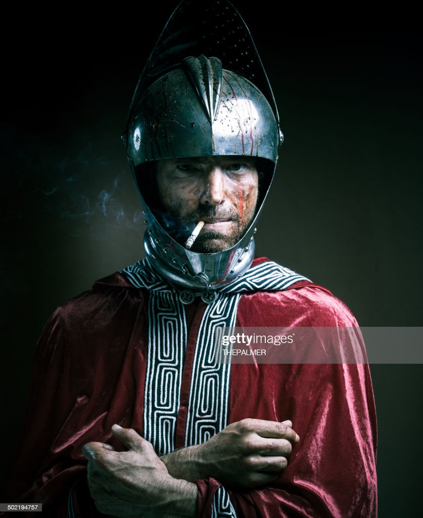bloody knight having a cigarette : Stock Photo