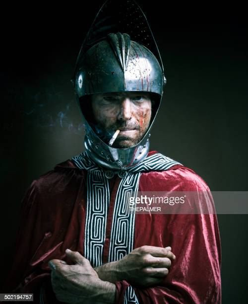 bloody knight having a cigarette - protective sportswear stock pictures, royalty-free photos & images