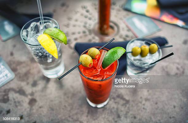bloody mary and cocktails on restaurant bar table - bloody mary stock photos and pictures