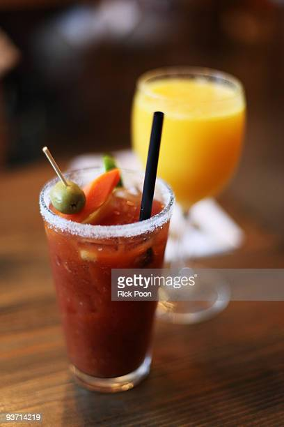bloody mary and orange juice - bloody mary stock photos and pictures