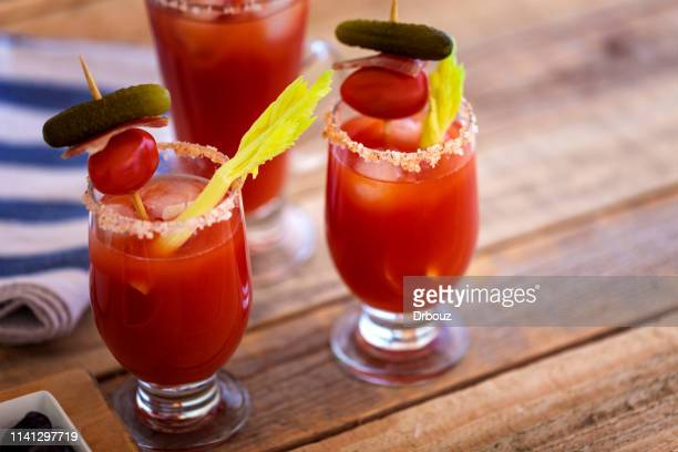 bloody mary cocktail in glass, close-up - bloody mary stock photos and pictures