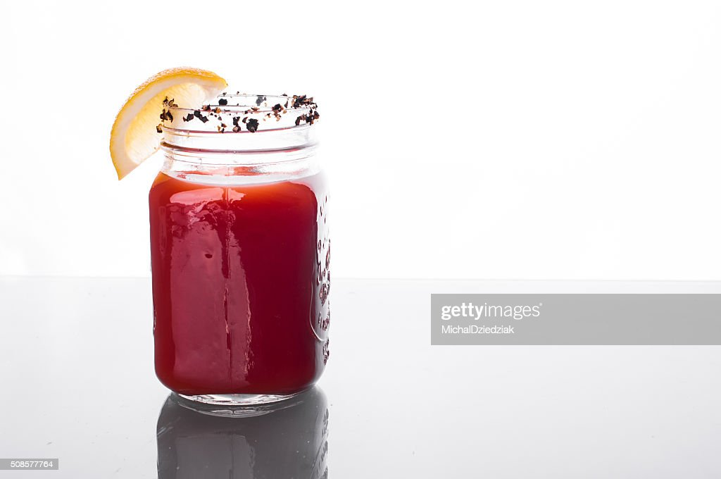 Bloody mary cocktail on glass table : Stock Photo