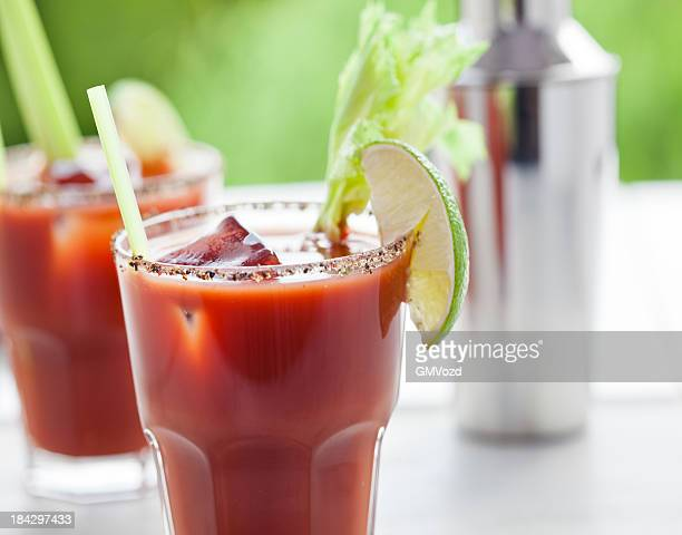 bloody mary or caesar cocktail  with lime, celery  and ice - bloody mary stock photos and pictures
