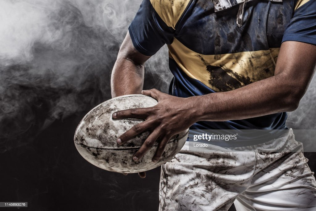 A bloody muddy Rugby Player : Stock Photo