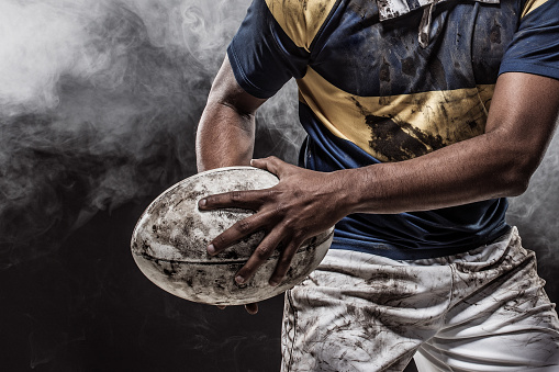 A bloody muddy Rugby Player 1145693076