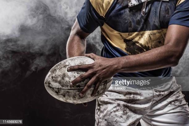a bloody muddy rugby player - rugby stock pictures, royalty-free photos & images