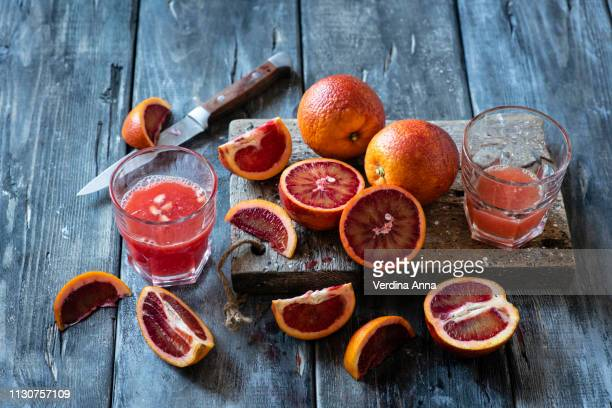 bloody oranges juice - anna verdina stock photos and pictures