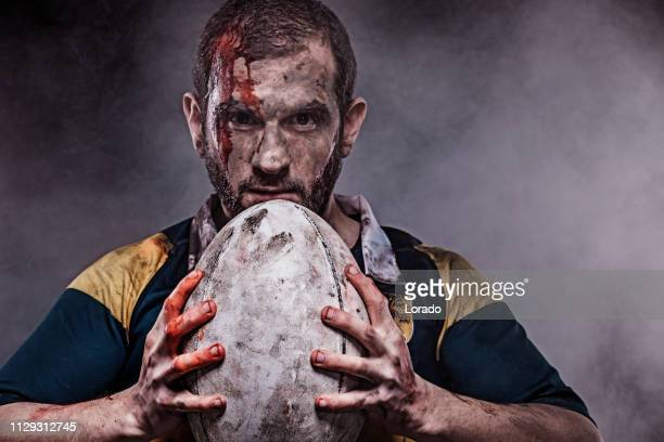 a bloody rugby player - tackling stock pictures, royalty-free photos & images