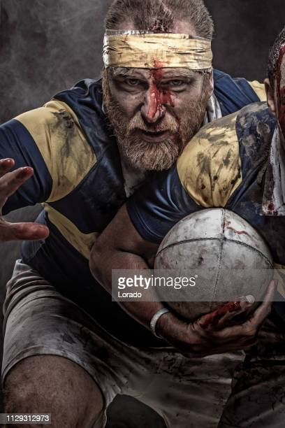 a bloody rugby player - tackling stock photos and pictures