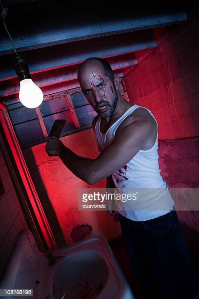 bloody scary halloween killer with knife in basement - blood in sink stock pictures, royalty-free photos & images
