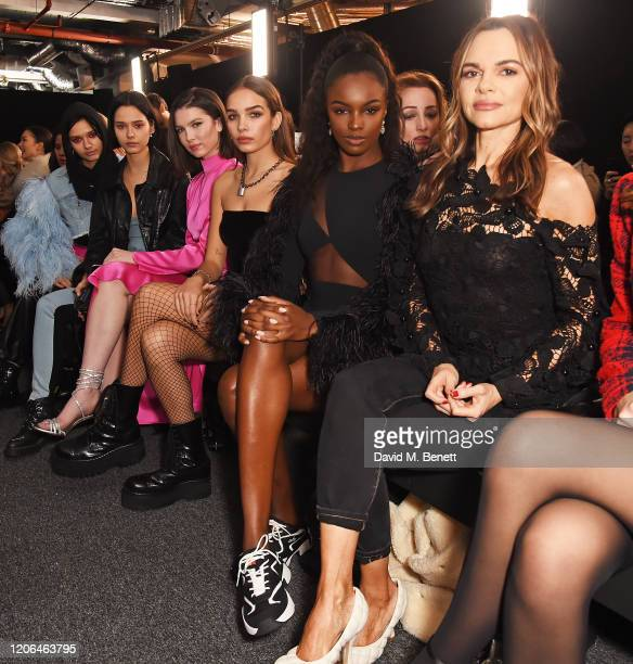 Bloom Twins Maya Henry Hana Cross Leomie Anderson wearing Ellesse shoes and Maria Hatzistefanis attend the DAVID KOMA show during London Fashion Week...