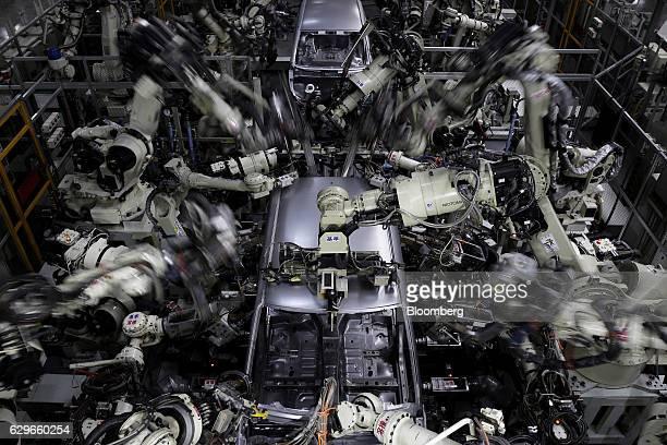 Robotic arms weld the body frames of Daihatsu Motor Co vehicles on the production line of the Daihatsu Motor Kyushu Co Oita plant in Nakatsu Oita...