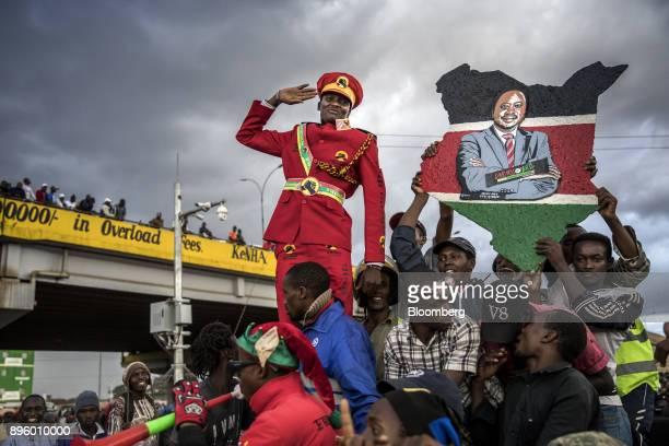 A supporter of Kenya's president Uhuru Kenyatta salutes from the crowd in Nairobi Kenya on Monday Oct 23 2017 Photographer Luis Tato/Bloomberg via...