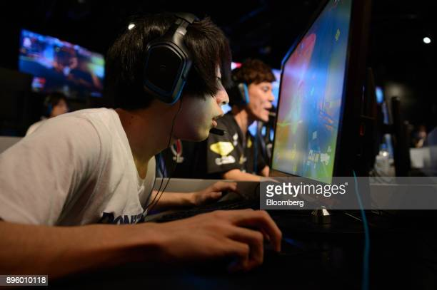 Attendees play Activision Blizzard Inc's Overwatch computer game at the AOC Open eSports event in Tokyo Japan on Saturday July 1 2017 Photographer...