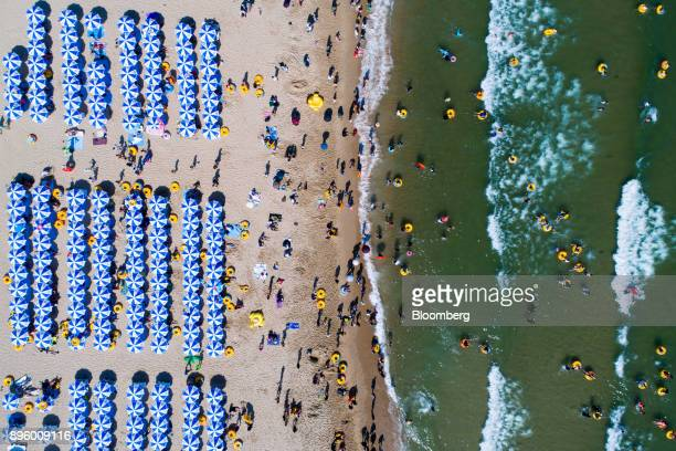 Bathers are seen on the beach and in the sea in this aerial photograph taken above Haeundae beach in Busan South Korea on Sunday July 16 2017...