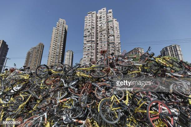 Coloured ridesharing bicycles sit in a pile in Shanghai China on Thursday Sept 12 2017 Photographer Qilai Shen/Bloomberg via Getty Images