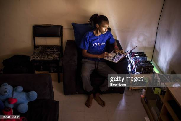 Eugene Mutai a bitcoin 'miner' and software developer poses for a photograph with cryptocurrency 'mining' machines at his home in Nairobi Kenya on...