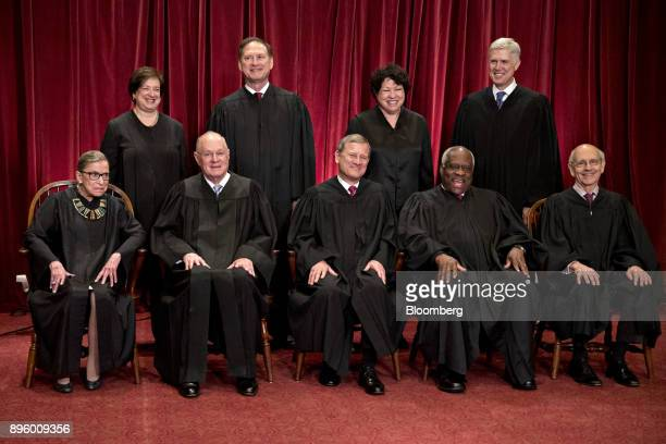 Justices of the US Supreme Court pose for a formal group photograph in the East Conference Room of the Supreme Court seated left to right Associate...