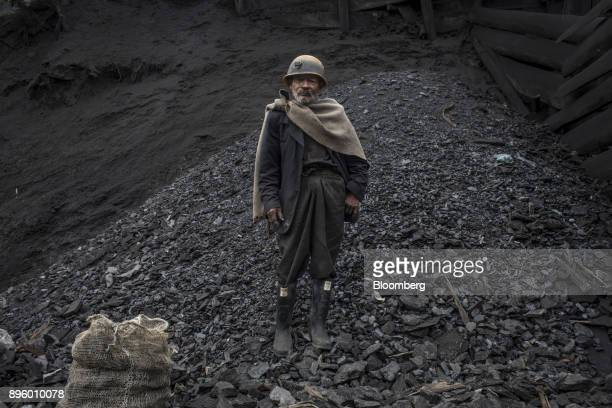 Miner Velasquez who is also a musician stands for a photograph outside a mine in Cucunuba Cundinamarca Department Colombia on Saturday July 2017...