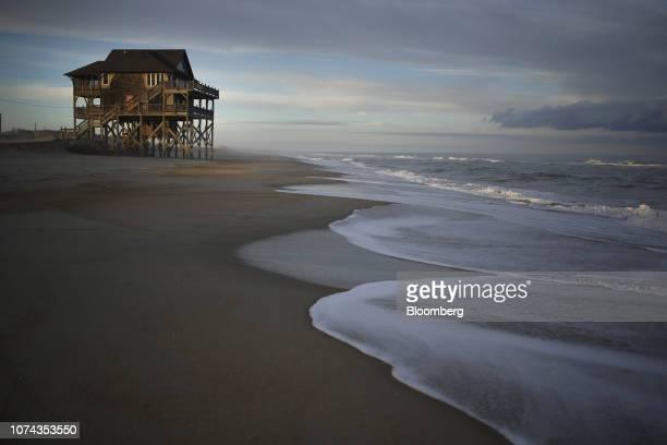 A beachfront house stands on the Outer Banks in Rodanthe North Carolina US on Wednesday Jan 10 2018 Photographer Luke Sharrett/Bloomberg via Getty...