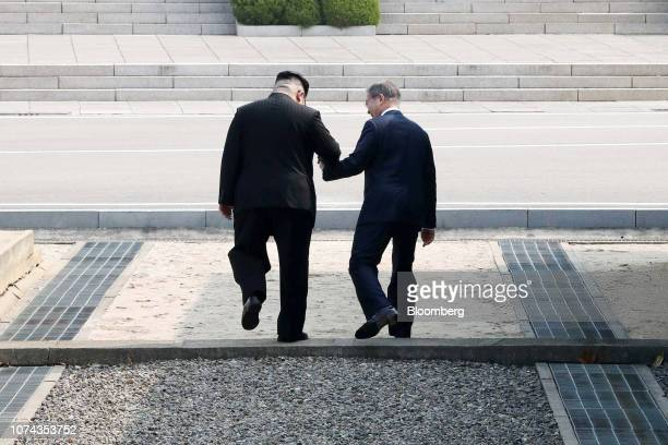 Kim Jong Un North Korea's leader left and Moon Jaein South Korea's president hold hands as they cross the Military Demarcation Line to the Northern...