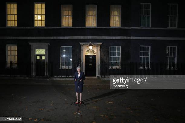 Theresa May UK prime minister delivers a statement following a special session of Cabinet to discuss the Brexit deal outside number 10 Downing Street...