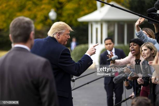 US President Donald Trump gestures while speaking to members of the media before boarding Marine One for West Virginia on the South Lawn of the White...