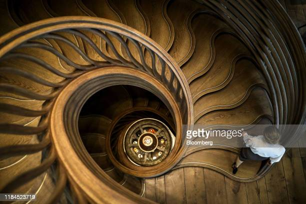 Bloomberg Best of the Year 2019: An employee walks up a spiral staircase at the Hide restaurant in the Mayfair district in London, U.K., on Tuesday,...